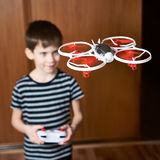Little boy drives toy quadcopter drone Stock Images
