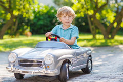 Free Little Boy Driving Big Toy Old Car, Outdoors Stock Images - 45640874