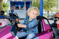 A little boy driving a bumper car Royalty Free Stock Images