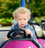 A little boy driving a bumper car Stock Images
