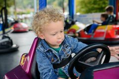 A little boy driving a bumper car Royalty Free Stock Photos