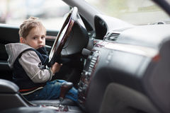 Little boy driving a car stock images