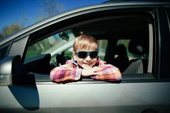 Little boy driving fathers car. Little cute boy driving fathers car at springtime Stock Photography