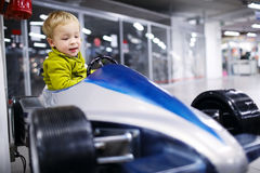 Little boy driving a racing car Royalty Free Stock Image