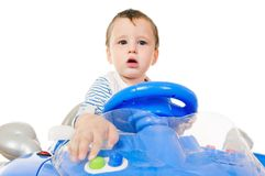 Little boy driving toy car Royalty Free Stock Images