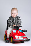 Little boy driving toy car Stock Photography
