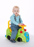 Little boy driving on toy car stock photos
