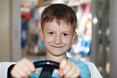 Little boy driving with toy at mall Stock Images