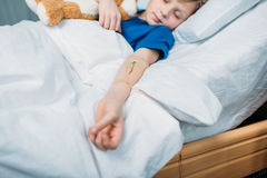 Little boy with drop counter sleeping in hospital bed Royalty Free Stock Image