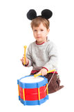 Little boy drumming Stock Photography