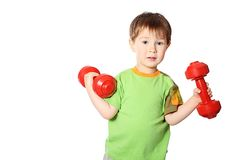 Little boy with dumbbells Stock Photos
