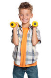 Little boy with dumbbells Royalty Free Stock Photography