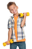 Little boy with dumbbells Stock Photo