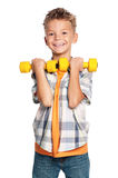 Little boy with dumbbells Stock Image