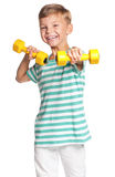 Little boy with dumbbells Royalty Free Stock Photos