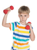 Little boy with dumbbells Royalty Free Stock Image