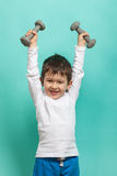 Little boy with dumbbells. Healthy lifestyle. Sports and activities for children. Stock Photos