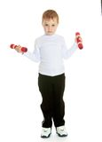 Little boy with dumbbells in his hands Stock Photo