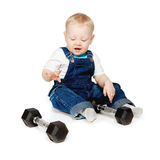 The little boy with dumbbells. Stock Image