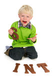 Little boy with Duth Sinterklaas chocolate Royalty Free Stock Photo
