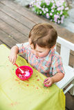 Little Boy Dyes his Easter Egg Pink Stock Images