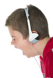 Little boy in ear-phones. On a white background Stock Photography