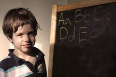 A little boy with an easel Stock Photos