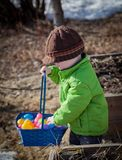 Little boy with Easter basket and eggs Stock Photo