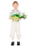 Little boy with easter eggs and flowers stock photo