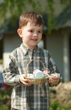 Little boy with Easter eggs outdoor Royalty Free Stock Images