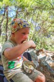 Little boy eat cereal outdoor in summer Royalty Free Stock Photo