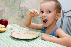 Little boy eat  porridge Stock Photo