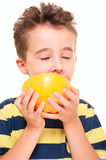 Little boy eatich grapefruit Royalty Free Stock Photo