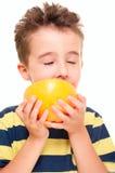 Little boy eatich grapefruit Royalty Free Stock Photo
