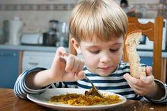 Little boy eating Stock Photos