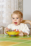 Little boy eating Stock Photography