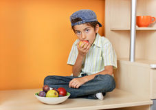 Little boy eating apple Royalty Free Stock Images