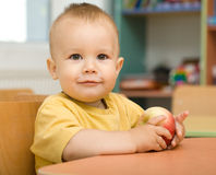 Little boy is eating apple Stock Image
