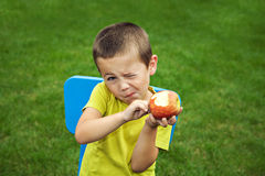 Little boy eating apple Royalty Free Stock Image