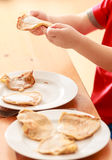Little boy eating apple pancakes at home Royalty Free Stock Image
