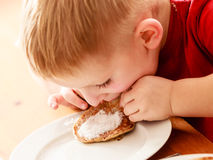 Little boy eating apple pancakes at home Royalty Free Stock Photos