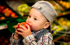 Little boy eating an apple Royalty Free Stock Images
