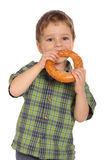 Little boy eating bagel Royalty Free Stock Images