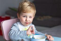Little boy eating breakfast stock image