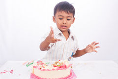 Little boy eating cake Royalty Free Stock Photography