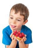 Little boy eating cakes Stock Photos