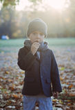 Little boy eating candy Stock Photos
