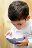 Little boy eating cherries Royalty Free Stock Image