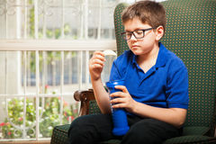 Little boy eating chips Stock Photography