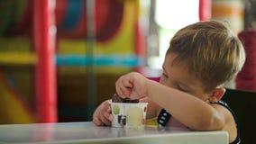 Little boy eating chocolate ice cream stock footage